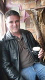Portrait of Man with Dark Stout Beer Royalty Free Stock Photo