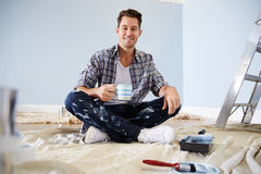 Portrait Of Man Decorating Nursery For New Baby Stock Photo