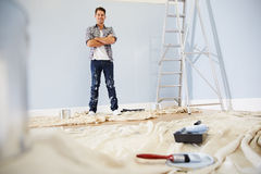 Portrait Of Man Decorating Nursery For New Baby Stock Image