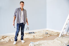 Portrait Of Man Decorating Nursery For New Baby Stock Photography
