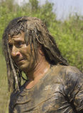 Portrait of a man dirt with mud Royalty Free Stock Image