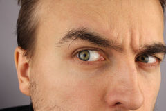 Portrait of a man, distrustful look, closeup Stock Images