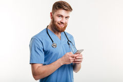 Portrait of man doctor using cellphone. Royalty Free Stock Photos