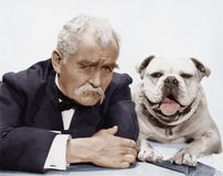 Portrait of man and dog Stock Images