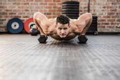 Portrait of man doing dumbbell push ups Royalty Free Stock Photos