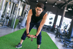 Portrait of a man doing stretching exercises at gym. Stock Image