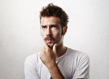 Portrait of a man in doubt Stock Images