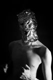 Portrait of a man dressed in scary masks foil. Closeup stock photography