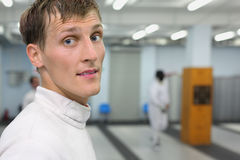 Portrait of man dressed in suit for fencing. Royalty Free Stock Photography