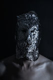 Portrait of man dressed in terrible metal mask Royalty Free Stock Image