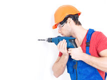 A man drilling a hole in the wall. Royalty Free Stock Images