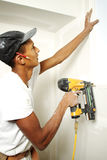 Portrait of a man drilling into a wall Royalty Free Stock Photography