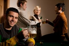 Portrait of man drinking beer at snooker Stock Photography