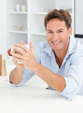 Portrait of a man drinking coffee in his kitchen Stock Photos