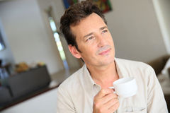 Portrait of a man drinking coffee at home stock photos