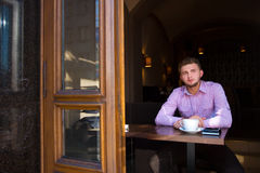 Portrait of a man drinking coffee Stock Photo