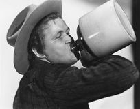 Portrait of man drinking from jug. (All persons depicted are no longer living and no estate exists. Supplier grants that there will be no model release issues Royalty Free Stock Photography