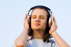 Portrait of a man with earphones Stock Photos