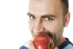 Portrait of a man eating an apple Stock Photos