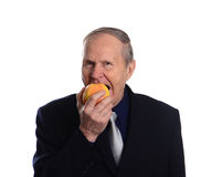 Portrait of a man, eating apple isolated on white background Stock Photo