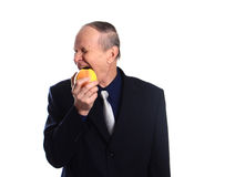 Portrait of a man, eating apple isolated on white background Stock Image