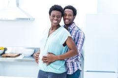 Portrait of man  embracing his wife while standing Stock Photos