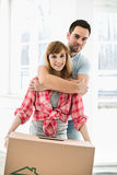 Portrait of man embracing woman in new house Royalty Free Stock Photography