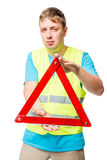 Portrait of a man with an emergency stop sign on a white backgro Stock Photo