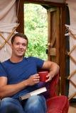 Portrait Of Man Enjoying Luxury Camping Holiday In Yurt Stock Image