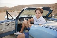 Portrait Of Man Enjoying Road Trip In Open Top Classic Car stock photos