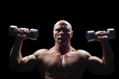 Portrait of man exercising with dumbbells Royalty Free Stock Image