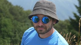 Portrait of man in fasionable sunglasses outdoor stock footage