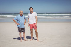 Portrait of man with father standing at beach Stock Photos