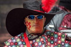 Portrait of man with festive costume watching camera during the carnival of Mulhouse stock photo