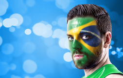Portrait of a man with the flag of the Brazil painted on his face Royalty Free Stock Photography