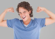 Portrait of Man flexing arm muscles with grey background. Digital composite of Portrait of Man flexing arm muscles with grey background Stock Photos