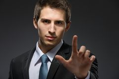 Portrait of man forefinger gesturing Royalty Free Stock Images