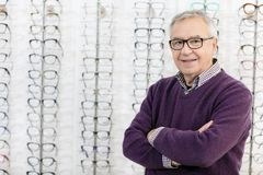 Portrait of man in frame glasses shop stock photo