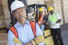 Portrait of a man in front of two workers Royalty Free Stock Photo