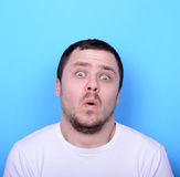 Portrait of man with funny face against blue background Stock Photo