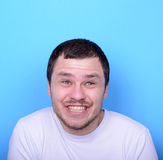 Portrait of man with funny face against blue background Royalty Free Stock Image