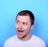 Portrait of man with funny face against blue background Royalty Free Stock Photos