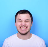 Portrait of man with funny face against blue background Stock Images