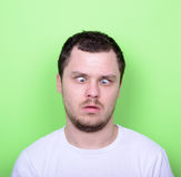 Portrait of man with funny face against green background Royalty Free Stock Photo