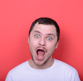 Portrait of man with funny face against red background Stock Image