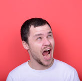 Portrait of man with funny face against red background Royalty Free Stock Photo