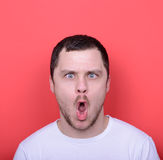 Portrait of man with funny face against red background Royalty Free Stock Photography