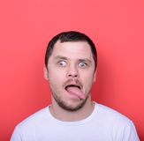 Portrait of man with funny face against red background Royalty Free Stock Photos
