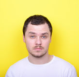 Portrait of man with funny face against yellow background Royalty Free Stock Photography