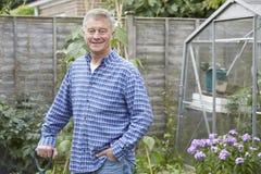Portrait Of Man Gardening At Home. Portrait Of Senior Man Gardening At Home Stock Images